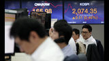 Currency traders work at the foreign exchange dealing room of the KEB Hana Bank headquarters in Seoul, South Korea, Tuesday, Oct. 22, 2019. Shares are gaining in Asia after upbeat comments from President Donald Trump and other U.S. officials on the status of trade negotiations with China. (AP Photo/Ahn Young-joon)