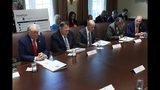Housing and Urban Development Secretary Ben Carson, second from the right, bows his head to lead a prayer before the start of the Cabinet meeting with from left, President Donald Trump, Secretary of State Mike Pompeo, Secretary of Labor Eugene Scalia, Carson, and Commerce Secretary Wilbur Ross, in the Cabinet Room of the White House, Monday, Oct. 21, 2019, in Washington. (AP Photo/Pablo Martinez Monsivais)