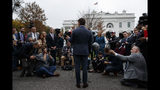 White House deputy press secretary Hogan Gidley talks with reporters outside the White House, Tuesday, Oct. 22, 2019, in Washington. (AP Photo/Evan Vucci)