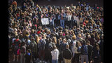 University of Connecticut students participate in a rally at UConn in front of the Student Union calling on administrative action in response to the video that surfaced last week of a group of students walking past a black student's dorm using racial slurs, in Storrs, Conn., Monday, Oct. 21, 2019. After a march through campus, students gathered around an oak leaf etched in the ground outside the student union, to voluntarily speak of their experiences while also calling for greater accountability from themselves and the university in reporting and eliminating racial incidents. (Mark Mirko/Hartford Courant via AP)