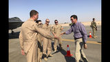 Defense Secretary Mark Esper talks with U.S. troops in front of an F-22 fighter jet deployed to Prince Sultan Air Base in Saudi Arabia, Tuesday, Oct. 22, 2019. (AP Photo/Lolita Baldor)