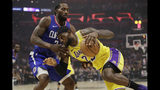 Los Angeles Lakers' LeBron James, right, is defended by Los Angeles Clippers' Kawhi Leonard during the first half of an NBA basketball game Tuesday, Oct. 22, 2019, in Los Angeles. (AP Photo/Marcio Jose Sanchez)
