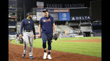 Houston Astros relief pitchers Josh James, left, and Will Harris leave the field after a brief workout, Monday, Oct. 14, 2019, at Yankee Stadium in New York,on an off day during the American League Championship Series against the New York Yankees. (AP Photo/Kathy Willens)
