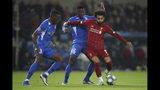 Liverpool's Mohamed Salah, right, vies for the ball with Genk's Jhon Lucumi, left, and Carlos Cuesta during a Champions League group E soccer match between Genk and Liverpool at the KRC Genk Arena in Genk, Belgium, Wednesday, Oct. 23, 2019. Salah scored once in Liverpool's 4-1 victory. (AP Photo/Francisco Seco)