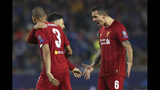 Liverpool's Alex Oxlade-Chamberlain, center, celebrates with Liverpool's Fabinho, left, and Liverpool's Dejan Lovren, right, after scoring the opening goal of the match during a Champions League group E soccer match between Genk and Liverpool at the KRC Genk Arena in Genk, Belgium, Wednesday, Oct. 23, 2019. (AP Photo/Francisco Seco)