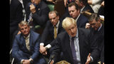 Britain's Prime Minister Boris Johnson speaks in the House of Commons in London following the debate for the EU Withdrawal Agreement Bill, Tuesday Oct. 22, 2019. British lawmakers have rejected the government's fast-track attempt to pass its Brexit bill within days, demanding more time to scrutinize the complex legislation and throwing Prime Minister Boris Johnson's exit timetable into chaos. (Jessica Taylor, UK Parliament via AP)