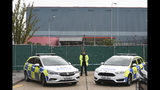Police officers block the road near the scene where a truck was found to contain a large number of dead bodies, in Thurrock, South England, early Wednesday Oct. 23, 2019. Police in southeastern England said that 39 people were found dead Wednesday inside the truck container believed to have come from Bulgaria. (Stefan Rousseau/PA via AP)