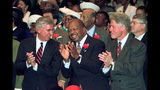 FILE - In this Sunday, Nov. 1, 1998 file photo, President Clinton, Rep. Elijah Cummings, D-Md., center, and Maryland Gov. Parris Glendening, left, participate in church services at New Psalmist Baptist Church in Baltimore, Md. Clinton urged members of the church Sunday to turn out in large numbers and support his party's candidates on Election Day. (AP Photo/Greg Gibson)