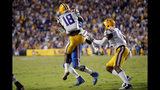 LSU linebacker K'Lavon Chaisson (18) stops Florida quarterback Kyle Trask on a fourth down near the goal line late in the second half of an NCAA college football game in Baton Rouge, La., Saturday, Oct. 12, 2019. LSU won 42-28. (AP Photo/Gerald Herbert)