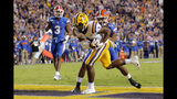 LSU wide receiver Ja'Marr Chase (1) pulls in a touchdown reception against Florida defensive back CJ Henderson (1) in the first half of an NCAA college football game in Baton Rouge, La., Saturday, Oct. 12, 2019. (AP Photo/Gerald Herbert)