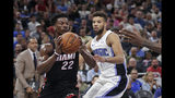 Miami Heat forward Jimmy Butler (22) passes the ball in front of Orlando Magic guard Michael Carter-Williams, right, during the first half of an NBA preseason basketball game, Thursday, Oct. 17, 2019, in Orlando, Fla. (AP Photo/John Raoux)
