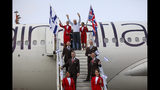 Richard Branson waves as he arrives to Ben Gurion airport to inaugurate the start of Virgin Atlantic airline in Israel, Wednesday, Oct. 23, 2019 in Tel Aviv, Israel. (AP Photo/Oded Balilty)