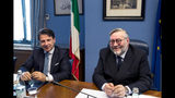Italian Premier Giuseppe Conte, left, sits next to COPASIR (Italian parliamentary intelligence committee) head Raffaele Volpi before testifying behind closed doors to the committee about a meeting between United States Attorney General William Barr and Italian intelligence, in Rome, Wednesday, Oct. 23, 2019. Media reports have indicated that Conte authorized the contacts -- one in August and one in September -- in violation of protocol. (Angelo Carconi/ANSA via AP)