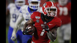 Georgia running back D'Andre Swift (7) drives in for Georgia's first touchdown of the night, in the second half against Kentucky during an NCAA college football game Saturday, Oct. 19, 2019, in Athens, Ga. (Joshua L. Jones/Athens Banner-Herald via AP)