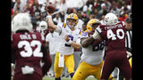 LSU quarterback Joe Burrow (9) passes for a first down against Mississippi State during the first half of their NCAA college football game in Starkville, Miss., Saturday, Oct. 19, 2019. In addition to LSU winning 36-13, Burrow threw four touchdowns to break the LSU season record with 29. (AP Photo/Rogelio V. Solis)