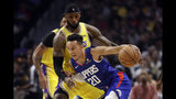 Los Angeles Clippers' Landry Shamet (20) is defended by Los Angeles Lakers' LeBron James during the first half of an NBA basketball game Tuesday, Oct. 22, 2019, in Los Angeles. (AP Photo/Marcio Jose Sanchez)