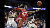 FILE - in this March 22, 2019, file photo, Ohio State's Kaleb Wesson (34) reaches for a rebound between Iowa State's Cameron Lard (2) and Marial Shayok (3) during the second half of a first-round game in the NCAA college basketball tournament in Tulsa, Okla. Ohio State looks to rebound after a disappointing, inconsistent season last season. (AP Photo/Jeff Roberson, File)