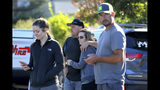 Brandon and Jessica Bayer, waiting for news of their son Andrew, 17, stand with student Jackelyn Strange, 17, left, and parent Blair Benson, right, as Santa Rosa police search the campus of Ridgway High School for suspects after a shooting at the school in Santa Rosa, Calif., Tuesday, Oct. 22, 2019. (Beth Schlanker/The Press Democrat via AP)