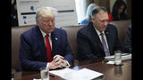 President Donald Trump, left, and Secretary of State Mike Pompeo, right, pause during an opening prayer given by Housing and Urban Development Secretary Ben Carson during a Cabinet meeting in the Cabinet Room of the White House, Monday, Oct. 21, 2019, in Washington. (AP Photo/Pablo Martinez Monsivais)