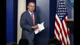 "FILE - In this Thursday, Oct. 17, 2019, file photo, White House chief of staff Mick Mulvaney arrives to a news conference, in Washington. On Sunday, Oct. 20, on ""Fox News Sunday,"" after acknowledging the Trump administration held up aid to Ukraine in part to prod the nation to investigate the 2016 elections, Mulvaney defended Trump's decision to hold an international meeting at his own golf club, although the president has now dropped that plan. (AP Photo/Evan Vucci, File)"
