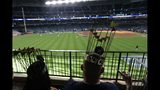 Fans watch batting practice before Game 2 of the baseball World Series between the Houston Astros and the Washington Nationals Wednesday, Oct. 23, 2019, in Houston. (AP Photo/Eric Gay)