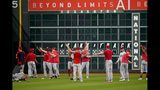 Washington Nationals players stretch before Game 2 of the baseball World Series against the Houston Astros Wednesday, Oct. 23, 2019, in Houston. (AP Photo/David J. Phillip)