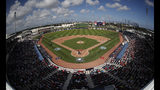 FILE - In this Feb. 28. 2017, file photo, theWashington Nationals and the Houston Astros play a spring training baseball game at Ballpark of the Palm Beaches in West Palm Beach, Fla. The game was the first to be played in the new stadium, which serves as both clubs' spring training home. The Houston-Washington World Series, which began Tuesday, is the first in the modern era to feature teams that share a common spring training site. In 1942, the Cardinals and Yankees met in the Series after playing their spring games in the same St. Petersburg, Fla., ballpark but training at different sites. (AP Photo/John Bazemore, File)