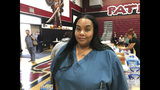 Qiana McCracken, assistant director of nursing at Riverside Heights Healthcare Center, said they were given 15 minutes warning to evacuate the facility on Wednesday, Oct. 30, 2019, from a brush fire in the hills. McCracken called 911 and helped get residents out of the facility, who were taken to a nearby school in Jurupa Valley, California. (AP Photo/Amy Taxin)