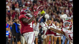 Alabama wide receiver Jerry Jeudy (4) catches a touchdown pass against Arkansas during the second half of an NCAA college football game, Saturday, Oct. 26, 2019, in Tuscaloosa, Ala. (AP Photo/Vasha Hunt)