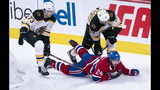 Montreal Canadiens' Phillip Danault is hooked by Boston Bruins' Patrice Bergeron, right, and falls oton the stick of Bruins' Charlie McAvoy during the second period of an NHL hockey game Tuesday, Nov. 5, 2019, in Montreal. (Paul Chiasson/The Canadian Press via AP)