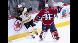 Boston Bruins' David Pastrnak rams into the boards behind the net while avoiding Montreal Canadiens goaltender Carey Price during the second period of an NHL hockey game Tuesday, Nov. 5, 2019, in Montreal. (Paul Chiasson/The Canadian Press via AP)