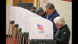 Voters caste their ballots at a polling station in Richmond, Va., Tuesday, Nov. 5, 2019. All seats in the Virginia House of Delegates and State senate are up for election. (AP Photo/Steve Helber)