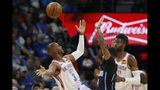 Oklahoma City Thunder guard Chris Paul (3) and forward Nerlens Noel, right, watch the ball after Paul was fouled by Orlando Magic guard D.J. Augustin, center, during the first half of an NBA basketball game in Oklahoma City, Tuesday, Nov. 5, 2019. (AP Photo/Sue Ogrocki)