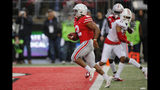 Ohio State running back J.K. Dobbins, left, scores a touchdown against Wisconsin during the second half of an NCAA college football game Saturday, Oct. 26, 2019, in Columbus, Ohio. Ohio State beat Wisconsin 38-7. (AP Photo/Jay LaPrete)