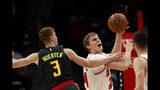Chicago Bulls forward Lauri Markkanen (24) goes up for a shot as Atlanta Hawks guard Kevin Huerter (3) defends in the first half of an NBA basketball game Wednesday, Nov. 6, 2019, in Atlanta. (AP Photo/John Bazemore)