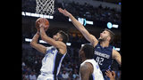Orlando Magic guard Michael Carter-Williams (7) shoots next to Dallas Mavericks center Maxi Kleber (42) during the first half of an NBA basketball game Wednesday, Nov. 6, 2019, in Dallas. (AP Photo/Richard W. Rodriguez)
