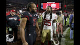 Arizona Cardinals wide receiver Larry Fitzgerald (11) greets San Francisco 49ers cornerback Richard Sherman (25) after an NFL football game, Thursday, Oct. 31, 2019, in Glendale, Ariz. The 49ers won 28-25. (AP Photo/Ross D. Franklin)