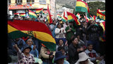 """Anti-government protesters against the reelection of President Evo Morales, attend a rally with the coca leaf growers in La Paz, Bolivia, Thursday, Nov. 7, 2019. The United Nations on Thursday urged Bolivia's government and opposition to restore """"dialogue and peace"""" after a third person was killed in street clashes that erupted after a disputed presidential election on Oct. 20. (AP Photo/Juan Karita)"""
