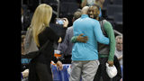 Boston Celtics' Kemba Walker, a former Charlotte Hornet, hugs old friends before an NBA basketball game between the teams in Charlotte, N.C., Thursday, Nov. 7, 2019. (AP Photo/Bob Leverone)