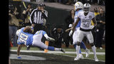 Los Angeles Chargers running back Austin Ekeler (30) scores a touchdown in front of Oakland Raiders cornerback Trayvon Mullen (27) during the second half of an NFL football game in Oakland, Calif., Thursday, Nov. 7, 2019. (AP Photo/Ben Margot)