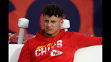 FILE - In this Thursday, Oct. 17, 2019, file photo, Kansas City Chiefs quarterback Patrick Mahomes sits on the bench prior to an NFL football game against the Denver Broncos in Denver. The Chiefs have ruled Mahomes out for Sunday night's showdown against the Green Bay Packers because of his dislocated right kneecap. Mahomes, who hurt his knee last Thursday night in Denver, was a limited participant in practice all week. (AP Photo/Jack Dempsey, File)