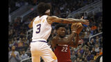 Phoenix Suns' Kelly Oubre Jr. (3) plays tough defense against Miami Heat's Jimmy Butler (22) during the first half of an NBA basketball game Thursday, Nov. 7, 2019, in Phoenix. (AP Photo/Darryl Webb)