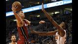 Miami Heat's Tyler Herro (14) drives to the lane against Phoenix Suns' Mikal Bridges (25) during the first half of an NBA basketball game Thursday, Nov. 7, 2019, in Phoenix. (AP Photo/Darryl Webb)