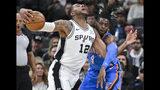 San Antonio Spurs' LaMarcus Aldridge (12) is fouled by Oklahoma City Thunder's Nerlens Noel during the first half of an NBA basketball game, Thursday, Nov. 7, 2019, in San Antonio. (AP Photo/Darren Abate)