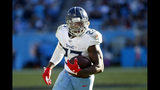 Tennessee Titans running back Derrick Henry (22) runs against the Carolina Panthers during the second half of an NFL football game in Charlotte, N.C., Sunday, Nov. 3, 2019. (AP Photo/Brian Blanco)