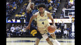 Akron's Channel Banks controls the ball against West Virginia during an NCAA college basketball game, Friday, Nov. 8, 2019, in Morgantown, W.Va. (AP Photo/Kathleen Batten)