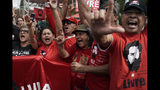 """Supporters of Brazil's former President Luiz Inacio Lula da Silva shout """"Good afternoon Lula"""" outside the Federal Police headquarters where the former leader is imprisoned in Curitiba, Brazil, Friday, Nov. 8, 2019. Da Silva's lawyers have begun legal procedures requesting his release from prison, following a Supreme Court decision late Thursday that a person can be imprisoned only after all appeals to higher courts have been exhausted. Da Silva has been detained since April 2018 after being convicted of corruption. (AP Photo/Leo Correa)"""