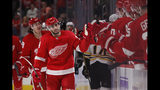 Detroit Red Wings center Robby Fabbri greets teammates after scoring during the first period of an NHL hockey game against the Boston Bruins, Friday, Nov. 8, 2019, in Detroit. (AP Photo/Carlos Osorio)