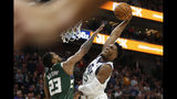 Utah Jazz guard Donovan Mitchell (45) dunks on Milwaukee Bucks guard Sterling Brown (23) during the first half of an NBA basketball game Friday, Nov. 8, 2019, in Salt Lake City. (AP Photo/Rick Bowmer)