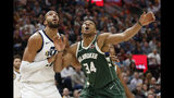 Utah Jazz center Rudy Gobert, left, and Milwaukee Bucks forward Giannis Antetokounmpo (34) look for a rebound during the first half of an NBA basketball game Friday, Nov. 8, 2019, in Salt Lake City. (AP Photo/Rick Bowmer)
